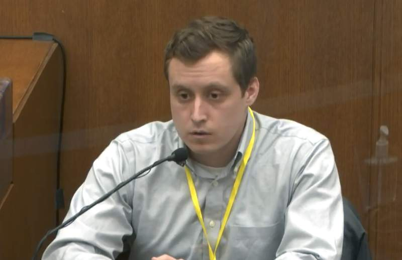In this image from video, witness Dr. Bradford Wankhede Langenfeld, the doctor who pronounced George Floyd dead, testifies as Hennepin County Judge PeterCahill presides Monday, April 5, 2021, in the trial of former Minneapolis police Officer Derek Chauvin at the Hennepin County Courthouse in Minneapolis.  Chauvin is charged in the May 25, 2020 death of George Floyd. (Court TV via AP, Pool)