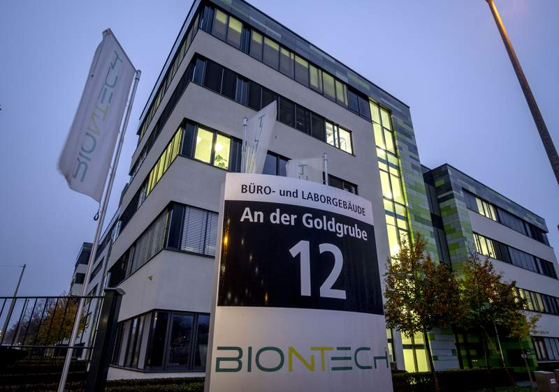 File -- In this Tuesday, Nov.10, 2020 file photo windows are illuminated at the headquarters of the German biotechnology company BioNTech in Mainz, Germany. German company BioNTech was little-known outside the pharmaceutical industry before it teamed up with U.S. giant Pfizer for Project Lightspeed that beat major rivals in the race to put the first thoroughly vetted vaccine on the market. (AP Photo/Michael Probst, file)