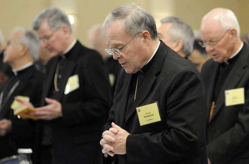 FILE - In this Monday, Nov. 10, 2008  file photo, Bishop Michael J. Hoeppner of Crookston, Minn. prays during a semi-annual meeting of the United States Conference of Catholic Bishops, in Baltimore. A Minnesota bishop who was investigated by the Vatican for allegedly interfering with past investigations into clergy sexual abuse has resigned. The Vatican said Tuesday, April 13, 2021 that Pope Francis had accepted the resignation of Crookston Bishop Michael Hoeppner and named a temporary replacement to run the dioceses. (AP Photo/ Steve Ruark, File)