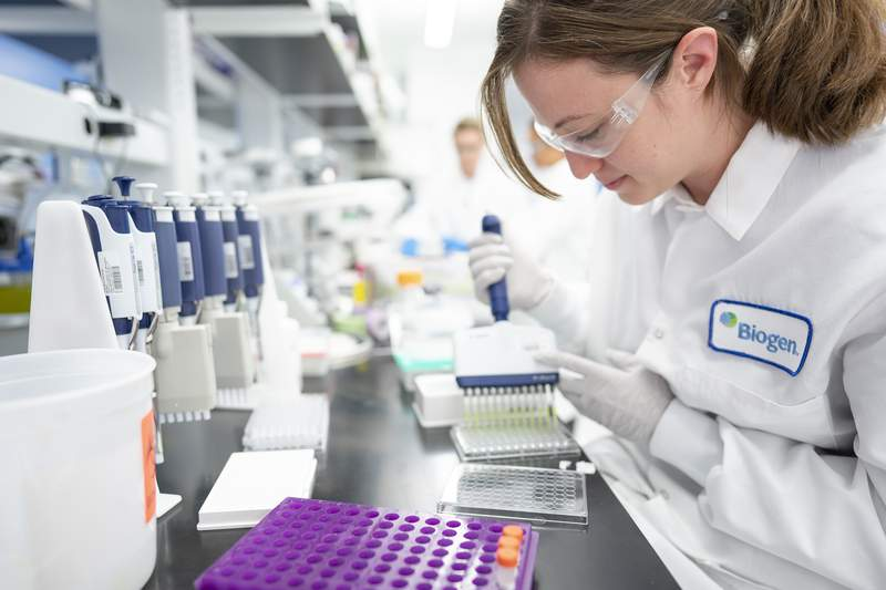 In this Dec. 12, 2019 photo provided by Biogen, a scientist works on Alzheimers disease research in a laboratory at the drugmakers headquarters in Cambridge, Mass. On Friday, Nov. 6, 2020, a panel of outside experts will meet to advise the Food and Drug Administration on the drug, called aducanumab from Biogen Inc. and Japans Eisai Co. The drug does not cure or reverse Alzheimers; the claim is that it modestly slows the rate of decline. (David A. White/Biogen via AP)