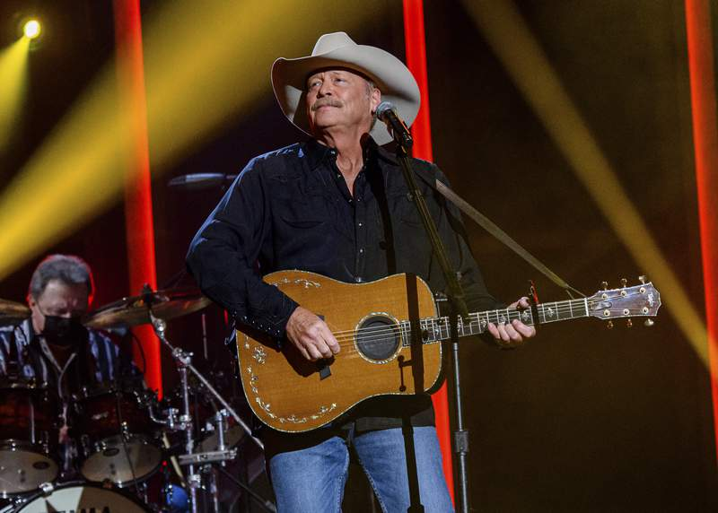 FILE - Alan Jackson performs at the 56th annual Academy of Country Music Awards on  April 15, 2021 in Nashville, Tenn. Jackson revealed in a new interview that he has a degenerative nerve condition that has affected his balance. The 62-year-old Country Music Hall of Famer said in an interview on NBC's Today show that he was diagnosed with Charcot-Marie-Tooth disease a decade ago. (Photo by Amy Harris/Invision/AP, File)