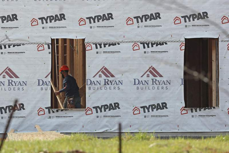 This March 17, 2020 photo shows construction work done on a new home in Mebane, N.C. U.S. housing construction fell 5.1% in August after three months of strong gains as home builders mounted a rebound following a pandemic-induced shutdown in March and April.   (AP Photo/Gerry Broome)