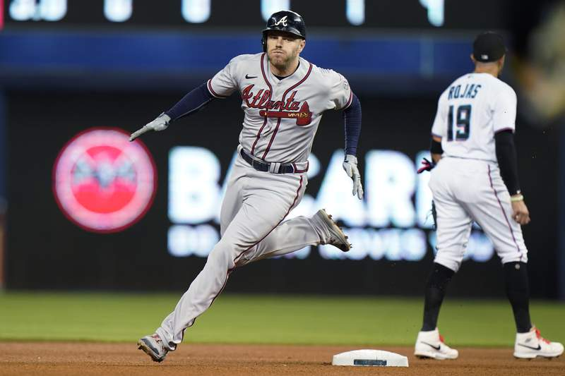 Atlanta Braves' Freddie Freeman rounds second base as he gets a triple during the fourth inning of a baseball game against the Miami Marlins, Wednesday, Aug. 18, 2021, in Miami. (AP Photo/Wilfredo Lee)