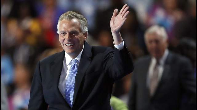 FILE - In this July 26, 2016 file photo, Virginia Gov. Terry McAuliffe waves on stage at the Democratic National Convention in Philadelphia. (AP Photo/Paul Sancya, File)