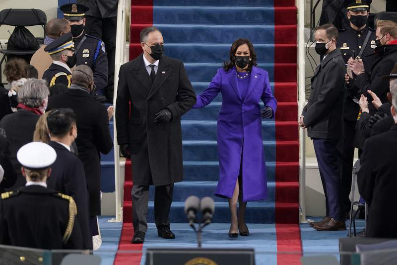 President-elect Kamala Harris and her husband Doug Emhoff, arrive for the 59th Presidential Inauguration at the U.S. Capitol in Washington, Wednesday, Jan. 20, 2021.(AP Photo/Patrick Semansky, Pool)