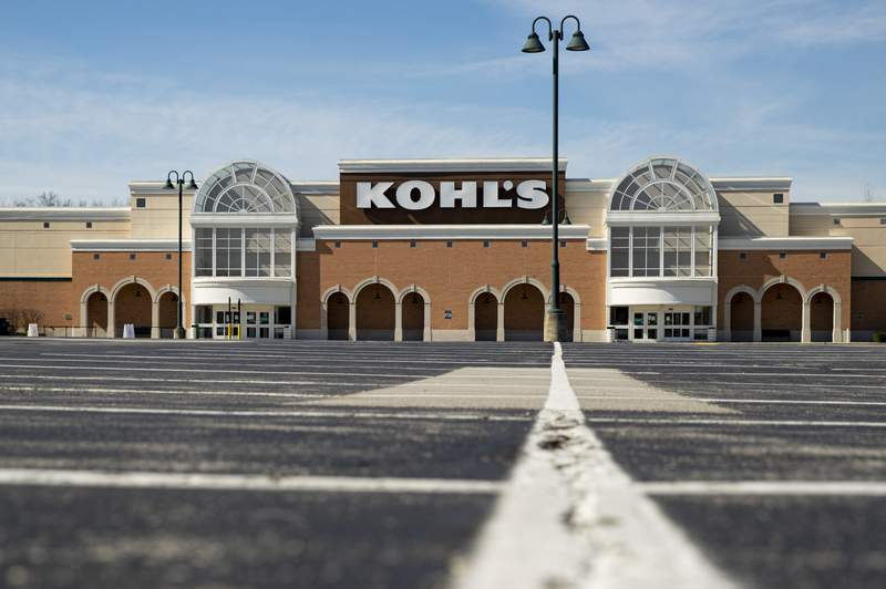 An empty parking outside a closed Kohl's store is shown in Indianapolis, Thursday, April 2, 2020. Kohls is fighting back against an investor groups efforts to take control of the department store chain's board, arguing that it would derail its progress and momentum. The response, issued Monday, Feb. 22, 2021 comes after the investor group said it had nominated nine members for Kohl's board of directors as it looks to boost the company's stock and its financial performance. The group owns a 9.5% stake in Kohl's. (AP Photo/Michael Conroy, file)