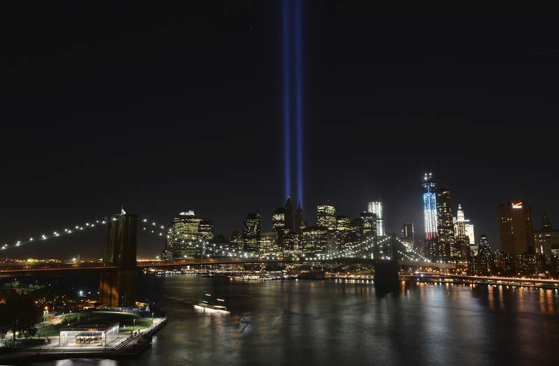 FILE - In this Sept. 11, 2012 file photo, The Tribute in Light lights up lower Manhattan in New York.  Plans are back on to beam twin columns of light into the Manhattan sky to represent the World Trade Center during next months anniversary of the 9/11 terror attacks. The Tunnel to Towers Foundation announced Friday, Aug. 14, 2020,  that it is working on plans to shine the twin beams during its alternative 9/11 ceremony.  (AP Photo/Henny Ray Abrams, File)