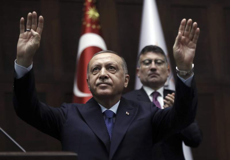 FILE - In this Wednesday, Oct 16, 2019 file photo, President Recep Tayyip Erdogan addresses his ruling party legislators at the Parliament in Ankara, Turkey. During the 2020 U.S. presidential campaign, Joe Biden drew ire from Turkish officials after an interview with The New York Times in which he called Erdogan an autocrat. (AP Photo/Burhan Ozbilici, File)