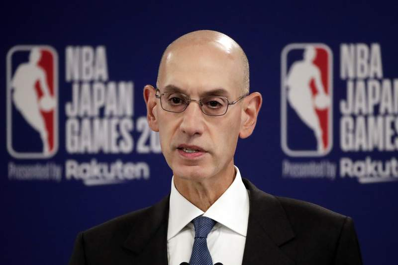 FILE - in this Oct. 8, 2019, file photo, NBA Commissioner Adam Silver speaks at a news conference before an NBA preseason basketball game between the Houston Rockets and the Toronto Raptors in Saitama, near Tokyo. Silver, in an interview with The Associated Press on Friday, Feb. 26, 2021, defended the leagues decision to have an All-Star Game in Atlanta on March 7 and said he believes the league can do so safely during a pandemic. (AP Photo/Jae C. Hong, File)