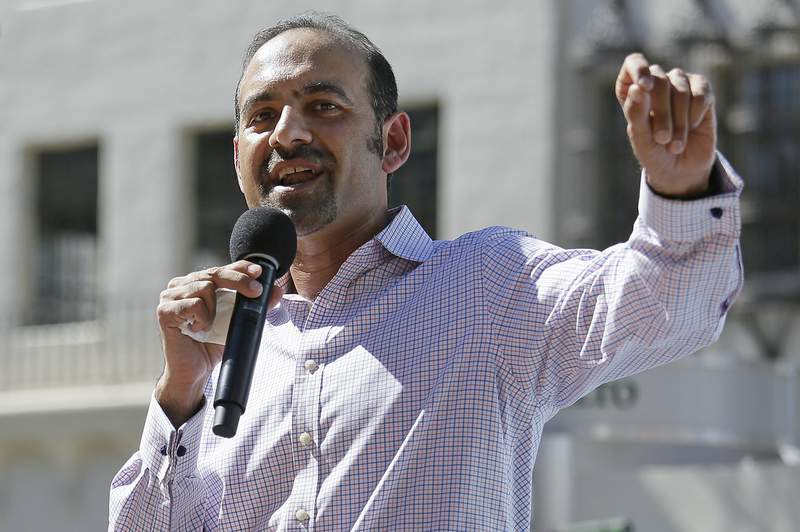 FILE - In this March 14, 2017, file photo Dilawar Syed, president of the software company Freshdesk, speaks during a Tech Stands Up rally outside City Hall in Palo Alto, Calif. If Syed is confirmed as deputy administrator of the Small Business Administration, he will be the highest-ranking Muslim in U.S. government. But his nomination is in peril as Senate Republicans block a committee vote, citing the agency's payouts to abortion providers  the latest in a series of objections to the Pakistani-born businessman's confirmation .(AP Photo/Eric Risberg, File)