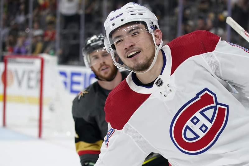 Montreal Canadiens center Nick Suzuki celebrates his open net goal during the third period in Game 5 of an NHL hockey Stanley Cup semifinal playoff series against the Vegas Golden Knights Tuesday, June 22, 2021, in Las Vegas. The Canadiens won 4-1. (AP Photo/John Locher)