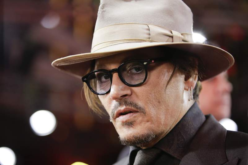 FILE - In this Friday, Feb. 21, 2020 file photo, actor Johnny Depp arrives for the screening of the film Minamata during the 70th International Film Festival Berlin, Berlinale in Berlin, Germany. Lawyers for British tabloid The Sun asked a judge on Thursday, June 25, 2020 to throw out Johnny Depps libel claim against the paper because the film star allegedly failed to disclose evidence relating to his drug use. Depp is suing the newspapers publisher News Group Newspapers and executive editor Dan Wootton over a 2018 article claiming he was violent and abusive to his ex-wife Amber Heard.(AP Photo/Markus Schreiber, File)
