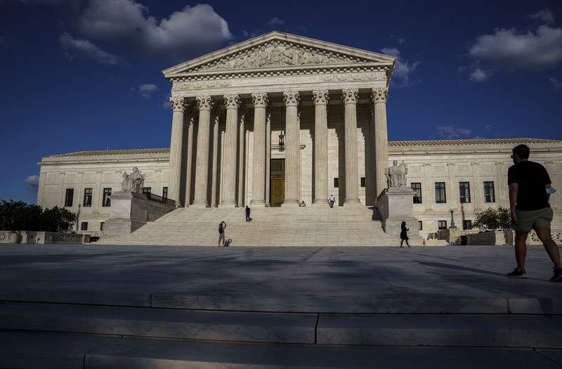In this Friday, Sept. 3, 2021 photo, the Supreme Court is shown in Washington. The Supreme Court plans to return to in-person arguments in October, but no public allowed. (AP Photo/J. Scott Applewhite)