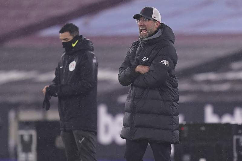 Liverpool's manager Jurgen Klopp reacts during the English Premier League match between West Ham and Liverpool at the the London Stadium in London, Sunday, Jan. 31, 2021. (John Walton/Pool via AP)