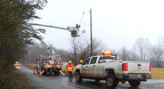 Appalachian Power crews work to restore power in Franklin County on Monday.