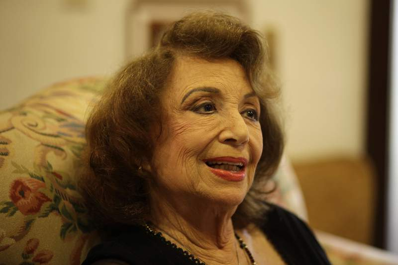 """FILE - In this Oct. 24, 2011 file photo, writer Delia Fiallo speaks during an interview in her home in Coral Gables, Fla. Fiallo, who wrote many successful telenovelas, such as """"Cristal"""" and """"Kasandra,"""" has died on Tuesday, June 29, 2021. (AP Photo/Lynne Sladky, File)"""