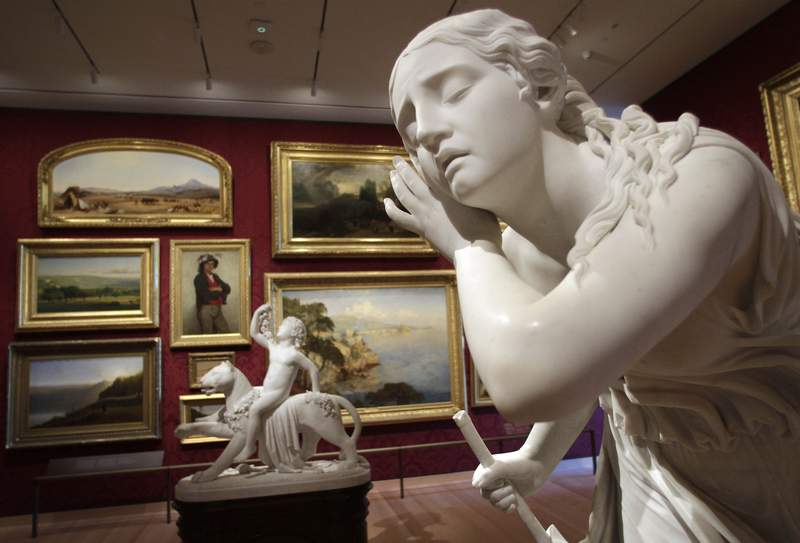 """FILE - In this Friday, Nov. 12, 2010, file photo, the 1856 sculpture """"Nydia the Blind Girl of Pompeii,"""" by Randolph Rogers, right, is seen in a gallery in the new The Art of the Americas Wing at the Museum of Fine Arts, in Boston. Boston's Museum of Fine Arts, one of the most prestigious such institutions in the world, has appointed its first director of belonging and inclusion, the latest in a series of efforts to make amends for allegations of racism. (AP Photo/Steven Senne, File)"""
