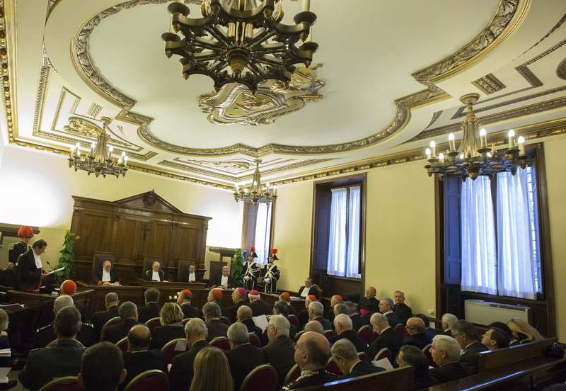 FILE - In this Saturday, Jan. 31, 2015 file photo, judge Giuseppe Dalla Torre, the president of the Vatican tribunal, center, attends the inauguration ceremony of the 86th Judicial Year of the Vatican tribunal at the Vatican. A former Vatican altar boy testified in the Vaticans criminal courtroom, Wednesday, March 17, 2021 that an older seminarian would come into his bed at night to masturbate him in the Vaticans youth seminary, saying his initial shock gave way to resignation because he feared being sent home. (AP Photo/Riccardo De Luca, File)