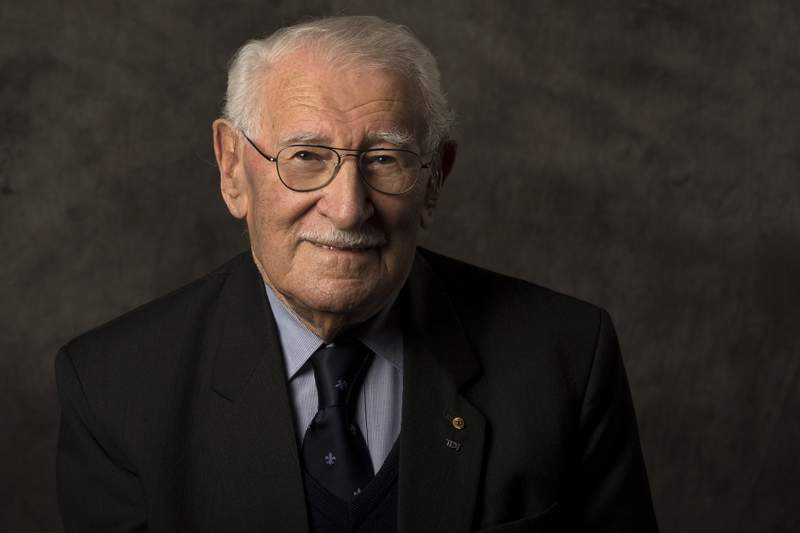In this undated photo provided by the Sydney Jewish Museum, Holocaust survivor Eddie Jaku poses for a photograph in Sydney, Australia. Jaku, who last year published his best-selling memoir, The Happiest Man on Earth, has died in Sydney, a Jewish community leader said. He was 101. (Sydney Jewish Museum via AP)