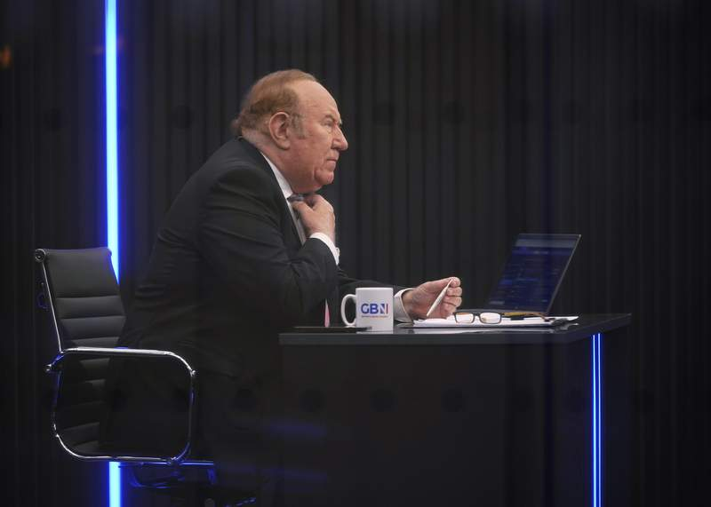 FILE - In this June 13, 2021 file photo, Andrew Neil is seen in the GB News studio in London. British broadcasting veteran Andrew Neil has stepped down as chairman of GB News, just three months after he launched it amid great fanfare and an ambition to provide an alternative to an alleged metropolitan elite bias among the established news channels. GB News, which has struggled for viewers since its launch and faced mockery on social media for a string of technical glitches, said Monday, Sept. 13 that the 72-year-old will continue to contribute as a regular guest commentator.