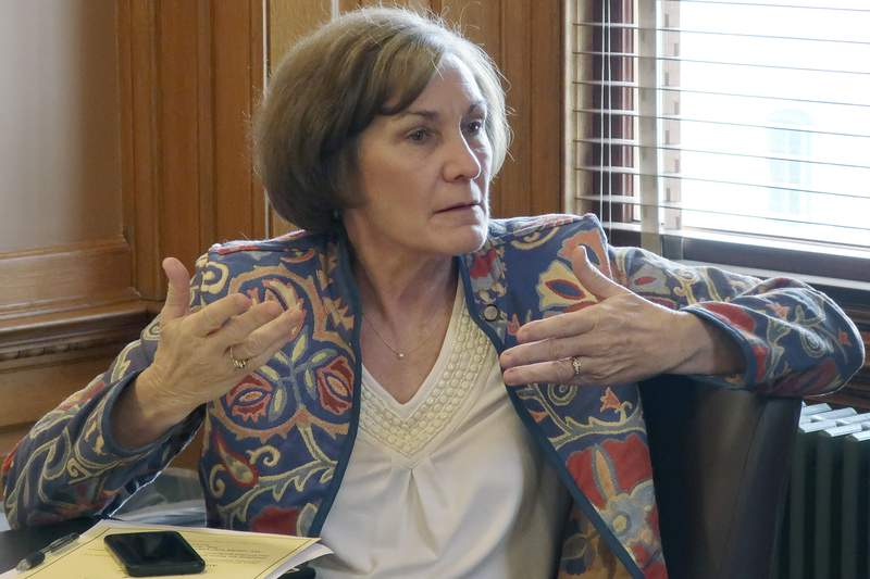 FILE - In this Feb. 13, 2019, file photo, state Sen. Barbara Bollier, D-Mission Hills, speaks during a meeting of Democratic senators at the Statehouse in Topeka, Kan. Bollier is pitching herself as a voice of reason with a decade's worth of working with lawmakers from both parties (AP Photo/John Hanna File)