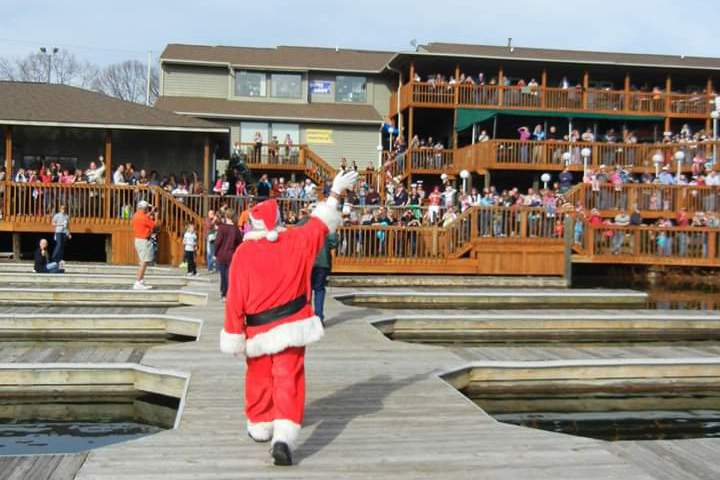 Santa Claus arrives by boat to Bridgewater Plaza as part of the annual Santa Around Bridgewater holiday event at Smith Mountain Lake.