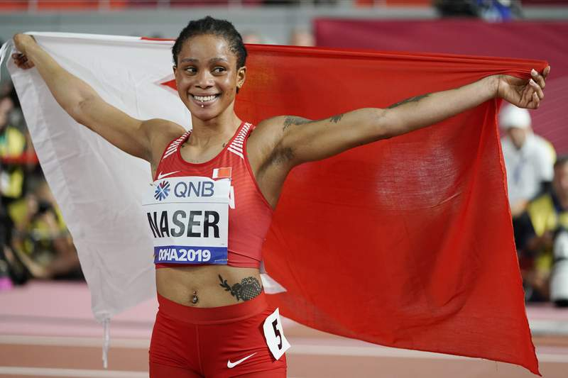 FILE - In this file photo dated Thursday, Oct. 3, 2019, Salwa Eid Naser of Bahrain, celebrates after winning gold in the women's 400 meter final at the World Athletics Championships in Doha, Qatar. Women's 400-meter world champion Salwa Eid Naser was provisionally suspended Friday June 5, 2020, by the Athletics Integrity Unit for not making herself available for doping tests, charging the sprinter with whereabouts violations.  (AP Photo/David J. Phillip, FILE)