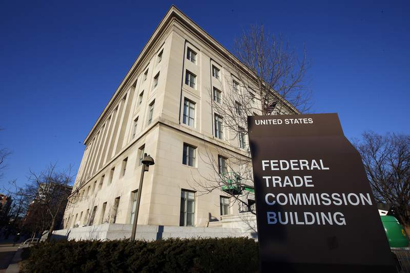 FILE - This Jan. 28, 2015, file photo, shows the Federal Trade Commission building in Washington. The Federal Trade Commission and six states are suing Frontier Communications for not delivering the internet speeds it promised customers and charging them for better, more expensive service than they actually got. In its complaint, filed Wednesday, May 19, 2021,  in federal court in California, the FTC said thousands of Frontier customers have complained that the company was not delivering promised speeds. Customers said they couldnt use the internet service for the online activities they should have been able to. Frontier says the lawsuit is without merit and it will defend itself.     (AP Photo/Alex Brandon, File)