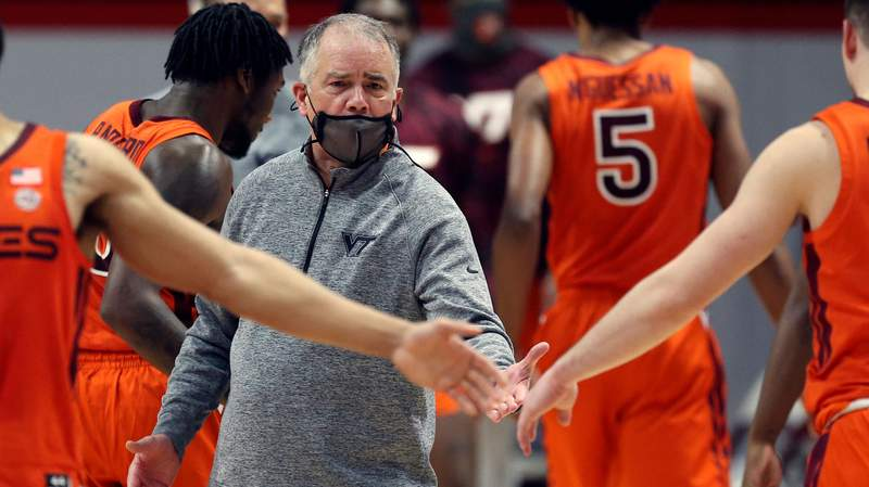 Virginia Tech head coach Mike Young celebrates with his team after a score during the second half of an NCAA college basketball game against Wake Forest, Saturday, Feb. 27, 2021, in Blacksburg, Va. (Matt Gentry/The Roanoke Times via AP, Pool)