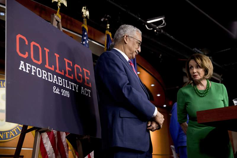FILE - House Speaker Nancy Pelosi of Calif., right, accompanied by Education and Labor Committee Chairman Rep. Bobby Scott, D-Va., left, speaks at a news conference to unveil the College Affordability Act on Capitol Hill in Washington, Tuesday, Oct. 15, 2019. Black college officials and advocates are concerned over looming budget cuts for transformational funding for the nations historically Black colleges. (AP Photo/Andrew Harnik)
