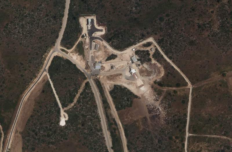 A satellite photo from Planet Labs Inc. shows what analysts describe as a test site for rocket motors at Israel's secretive Sdot Micha Air Base on Saturday, April 24, 2021. A mysterious blast heard earlier this month in central Israel appears to have come during a rocket engine test conducted at a secretive military base associated with the country's missile program, according to an analyst and satellite images. (Planet Labs Inc. via AP)