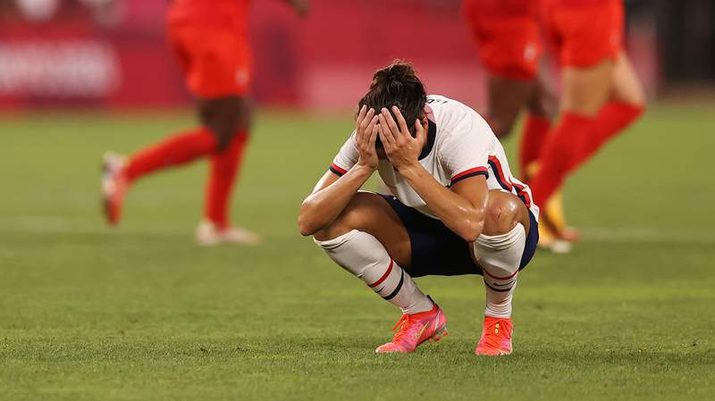 Carli Lloyd of Team USA looks dejected following defeat to Canada on day ten of the Tokyo Olympic Games at Kashima Stadium.