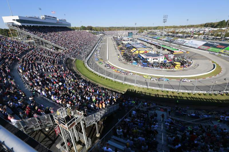 In this Oct. 27, 2019, file photo, people watch the start of a NASCAR Cup Series race at Martinsville Speedway in Martinsville, Va. (AP Photo/Steve Helber, File)