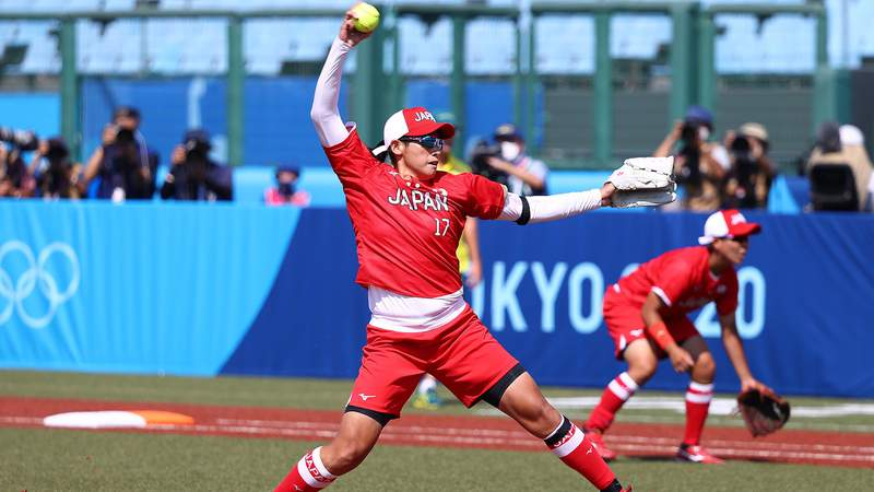 Pitcher Yukiko Ueno of Japan winds up for a pitch in the first inning during the Tokyo 2020 Olympic Games against Australia at Fukushima Azuma Baseball Stadium.