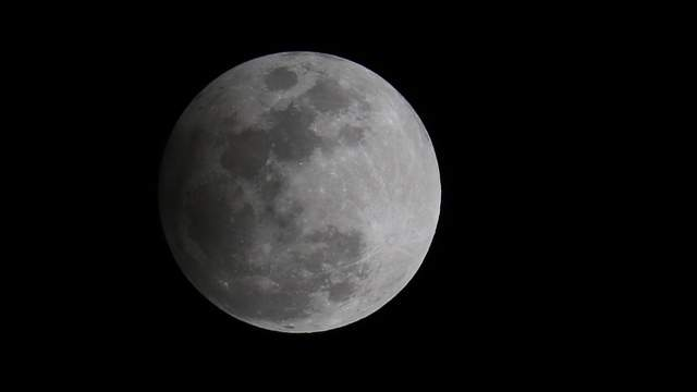 A slight shade is cast on the moon as see outside WKMG studios on Friday, Feb. 10, 2017. A penumbral lunar eclipse happens when the Earth's outer shadow created by the sun, known as the penumbra, creates a slight eclipse of the moon.