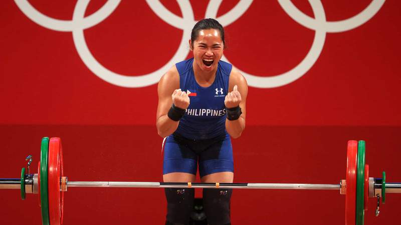 Hidilyn Diaz celebrates on her way to a gold medal and Olympic record in women's 55kg weightlifting.
