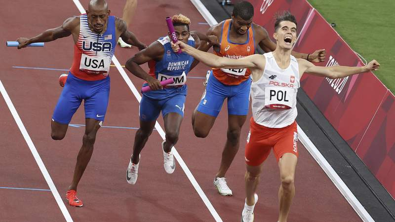 TOKYO, JAPAN - JULY 31, 2021: Poland's Kajetan Duszynski, gold medalist, the Netherlands' Ramsey Angela, Dominican Republic's Alexander Ogando, silver medalist, and the USA's Vernon Norwood (R-L), bronze medalist, finish the 4x400m mixed relay athletics final during the 2020 Summer Olympic Games at the Japan National Stadium. Valery Sharifulin/TASS (Photo by Valery Sharifulin\TASS via Getty Images)