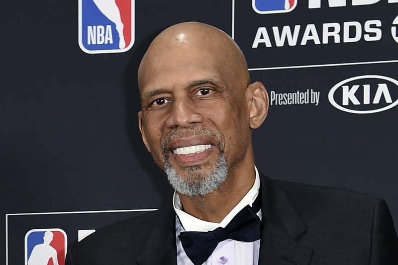 FILE - Kareem Abdul-Jabbar poses in the press room at the NBA Awards in Santa Monica, Calif. on June 25, 2018. The NBA legend serves as an executive producer and narrator of the one-hour documentary Fight the Power: The Movements That Changed America, which airs June 19 on the History Channel. (Photo by Richard Shotwell/Invision/AP, File)