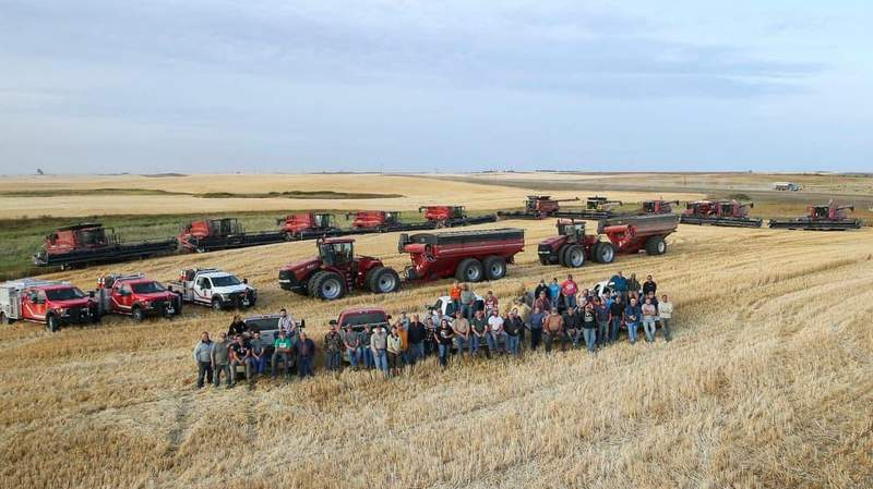Farmers who pitched in to harvest neighbor's crops after he suffered a heart attack.