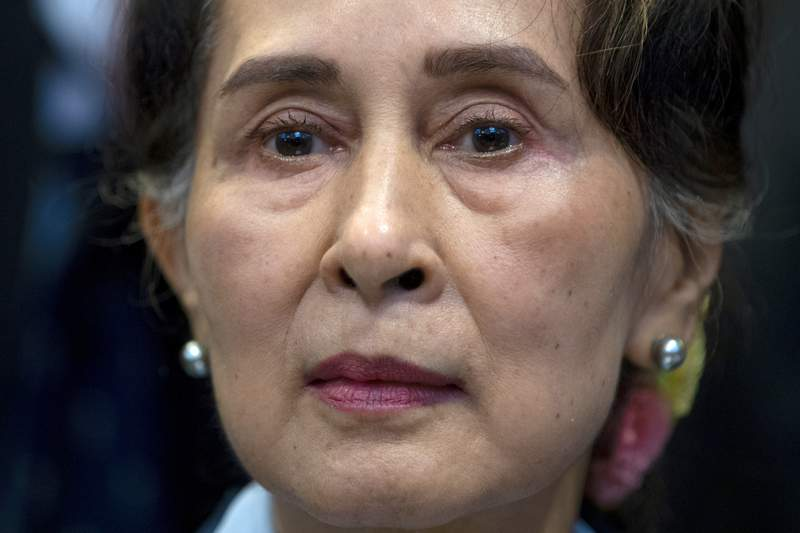 FILE - In this Dec. 11, 2019, file photo, Myanmar's leader Aung San Suu Kyi waits to address judges of the International Court of Justice in The Hague, Netherlands. Myanmars Anti-Corruption Commission has found that ousted national leader Aung San Suu Kyi had accepted bribes and misused her authority to gain advantageous terms in real estate deals, government-controlled media in the military-ruled country reported Thursday, June 10, 2021. (AP Photo/Peter Dejong, File)