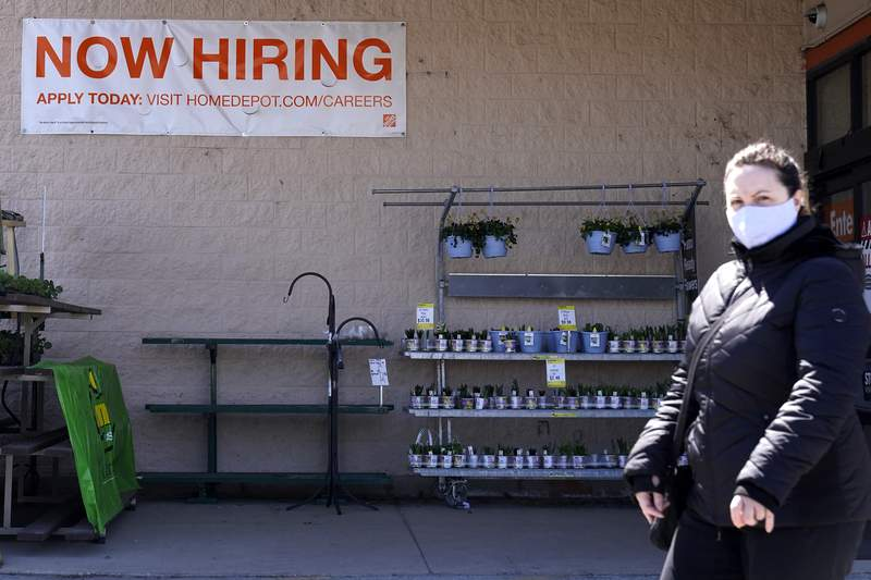 A hiring sign is seen outside home improvement store in Mount Prospect, Ill., Friday, April 2, 2021.  The pace of job openings reached the highest level on record in February, a harbinger of healthy hiring and a hopeful sign for those looking for work.  (AP Photo/Nam Y. Huh)
