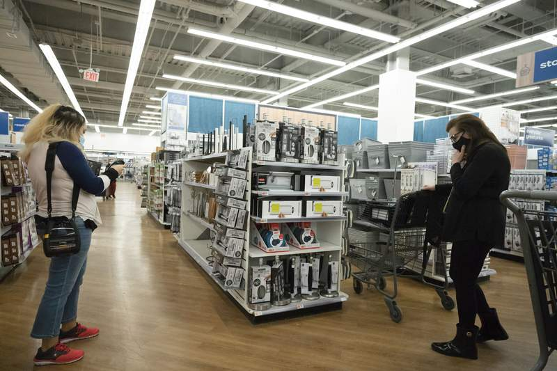 FILE - In this March 25, 2021 file photo, shoppers look at items in Bed, Bath and Beyond, in New York. U.S. consumer prices increased a sharp 0.6% in March, the biggest increase since 2012, while inflation over the past year rose a sizable 2.6%. The big gains were expected to be a temporary blip and not a sign that long dormant inflation pressures were emerging. (AP Photo/Mark Lennihan, File)