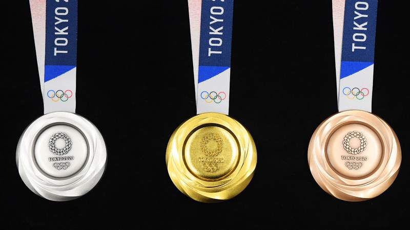 The silver, gold and bronze medals are displayed after the Tokyo 2020 medal design unveiling ceremony. Photo by Atsushi Tomura