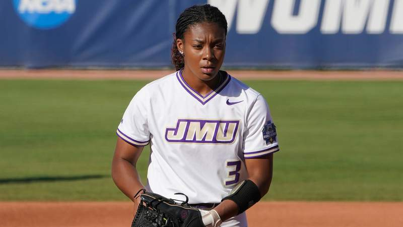James Madison's Odicci Alexander pitches in the first inning against Oklahoma State in a Women's College World Series softball game against Oklahoma State, Friday, June 4, 2021, in Oklahoma City. (AP Photo/Sue Ogrocki)
