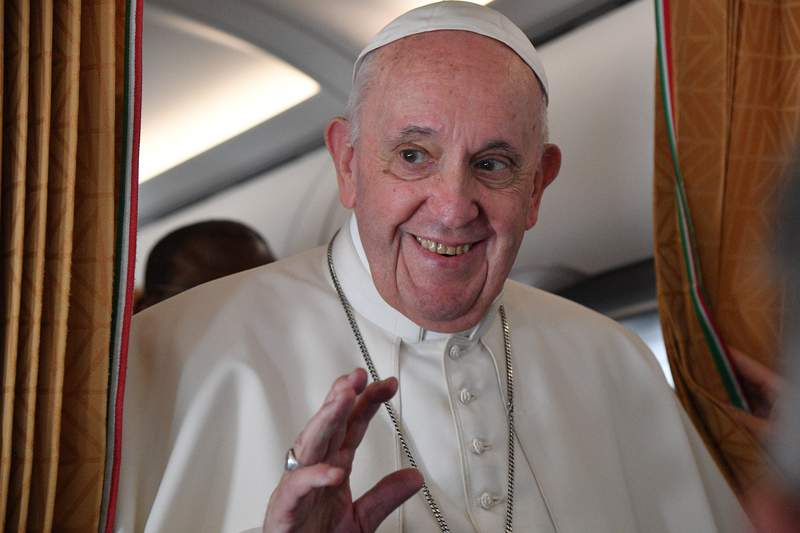 Pope Francis speaks with journalists on board an Alitalia aircraft enroute from Bratislava back to Rome, Wednesday, Sept. 15, 2021 after a four-day pilgrimage to Hungary and Slovakia. (Tiziana Fabi, Pool via AP)