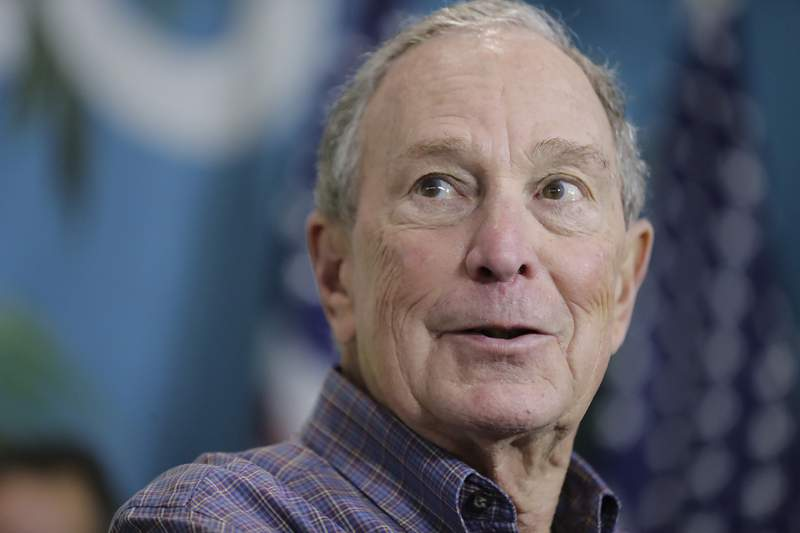 Former New York City Mayor Mike Bloomberg speaks during a news conference on Tuesday, March 3, 2020, in Little Havana, a neighborhood in Miami. Florida authorities on Wednesday, May 5, 2021 closed a criminal investigation into fund-raising efforts by Bloomberg to pay off the outstanding fines of thousands of the state's felons seeking to reclaim their voting rights, finding no violations of election law. (AP Photo/Brynn Anderson, file)