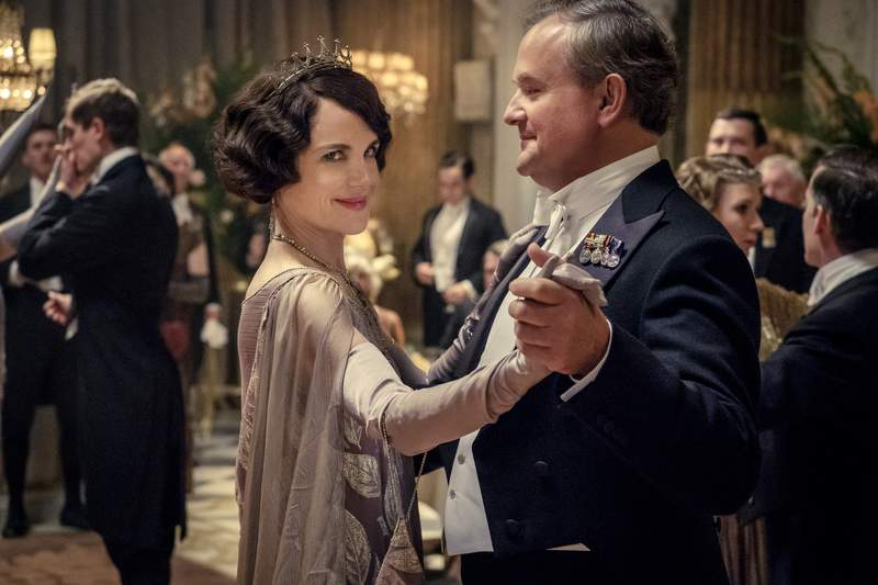 """This image released by Focus Features shows Elizabeth McGovern, left, as Lady Grantham and Hugh Bonneville, as Lord Grantham, in """"Downton Abbey"""". The original principal cast of Downton Abbey are returning for a second film that will arrive in theaters December 22 this year, Focus Features announced Monday. Downton Abbey creator Julian Fellowes has written the screenplay, and Simon Curtis is directing. (Jaap Buitendijk/Focus Features via AP)"""