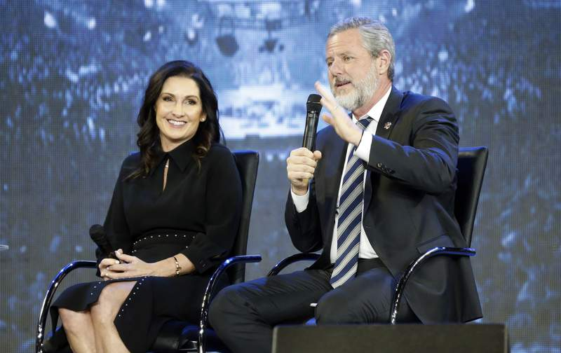 """FILE -This Wednesday Nov. 28, 2018 file photo shows Rev. Jerry Falwell Jr., right, and his wife, Becki during after a town hall at a convocation at Liberty University in Lynchburg, Va. Falwell Jr. says he is seeking help for the """"emotional toll"""" from an affair his wife had with a man who he says later threatened his family. (AP Photo/Steve Helber)"""