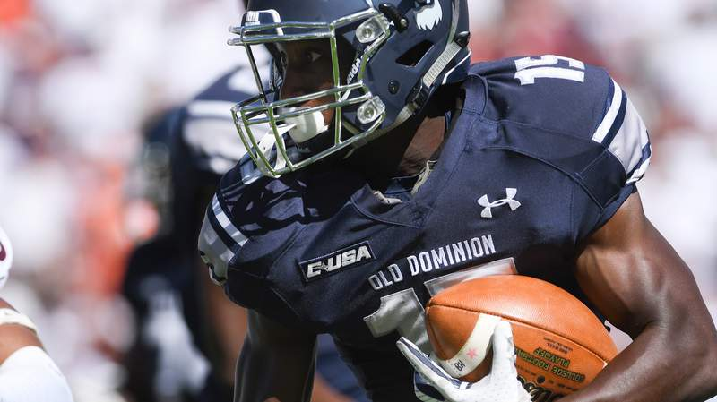 Wide receiver Isaiah Harper #15 of the Old Dominion University Monarchs carries the ball following his reception against the Virginia Tech Hokies in the first half at Lane Stadium on September 23, 2017 in Blacksburg, Virginia. Virginia Tech defeated Old Dominion 38-0. (Photo by Michael Shroyer/Getty Images)