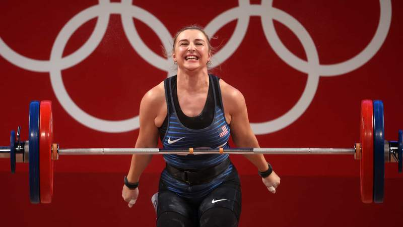 U.S. weightlifter Kate Nye shows her happiness with her effort.